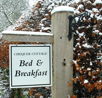B and B sign in snow