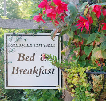 B and B sign with hanging basket